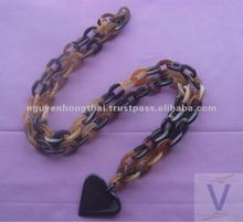 Buffalo horn necklace, natural honey horn with the black heart. Size 120cm long