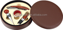 Offer round brown colour PU leather box with wine opener and bottle stopper wine set