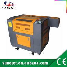CE FDA 60w laser cutting steel machinery,rubber sheet laser cutting machine,cutting machine with auto feeding system
