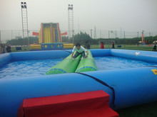 2015 hot sell customized design and style 0.9mm pvc tarpaulin large inflatable pool slide