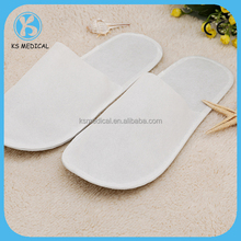 Cheap disposable non woven hotel slipper massage man and women slopper