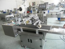 adhesive labeliEfficient automatic packing machine, self ng machine manufacturers