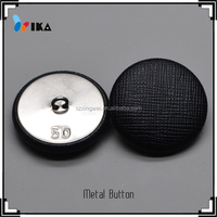 Leather covered custom made metal buttons