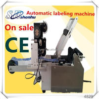 China automatic high quality labeler machine for flat bottle lid