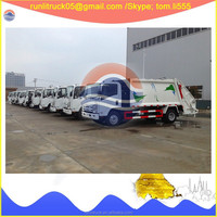 Japanese garbage truck supplier for isuzu elf QL11109KARY 4*2 8 cubic meters garbage transport vehicle sale in mongolia