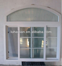 arched top sliding window with grill design