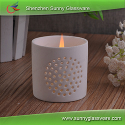 White porcelain candle holder with cut out flower