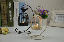 wonderful cage shape candlestick surrounded by butterfly adornment for home decoration