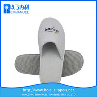 white disposable terry hotel slippers from free photos library