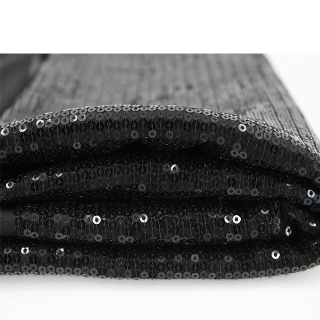 Elegante Color negro punto claro lentejuelas tela para vestir lentejuelas tela el perno