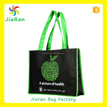 A picture of health, Black non woven bag with green color logo , long handle bag
