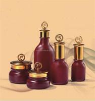 Elegant red cosmetic glass jar