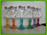 color glass mason jar on stem with handle and metal lid