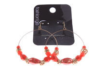 red plastic balls and alloy ear stud