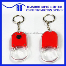 Supply hot selling cheap logo printed magnifying glass LED plastic led keychain for promotion