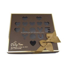 brown heart gift box with heart and words shaped hollow design, the gift box placed chocolate, candy and so on