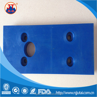 Impact resistant blue drilled UHMWPE pad