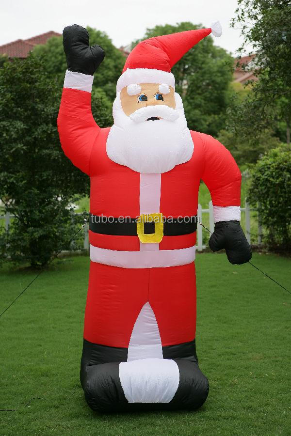 big inflatable santa clause on thr roof