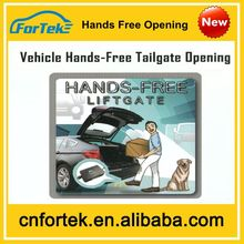 Hands free tail gate opening system