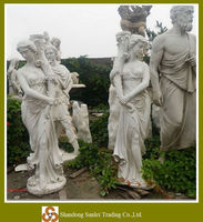 white marble maiden statue with lamp