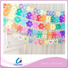 Artificial Hand Making Coloful Paper Garland for Wedding