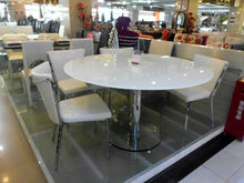Extended Round Glass Dining Table