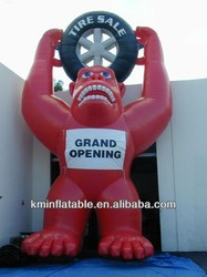 inflatable gorilla holding a tire