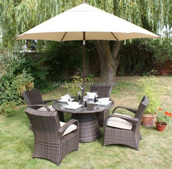 2016 UK style rattan dinner set with bended arm matching round tables with glass top dining chairs with armrests