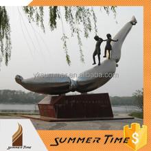 Playing bronze children sculpture on stainless steel