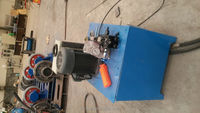 Button head making machine for pre-tensioned piles