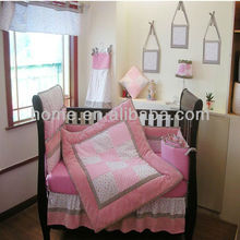 girl nursery bedding with patchwork quilt