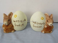 Stock pottery rabbit with easter egg designs coin box