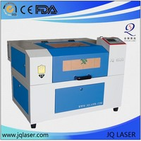 European routs acrylic foam plastic wood cutting machine on Alibaba/ CO2 laser engraving machine for carving acrylic and plastic