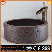 Chinese red stylish ceramic wash basin with with half lion's body and half divine's face sculpture