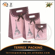 Hot Stamping Surface Handling cosmetic packing paper bag with logos