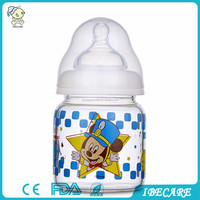 cheap price bpa free standerd neck 120/240ML standerd neck glass baby bottle, anti-slip baby milk glass bottle protective cover