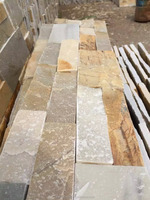 Stacked beige slate cultured stone retaining wall