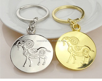 Wholesale and OEM stock zinc alloy Anaglyph logo silver or gold goat zodiac keychain for birthday