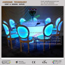 modern round dinning table and led chairs
