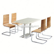 British rustic solid wood dining table with chenille fabric chairs