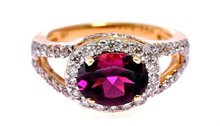 18k Gold Rhodolite ring with shimmering diamonds