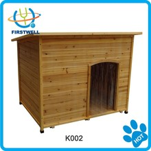 Wooden outdoor dog kennel with asphalt roof