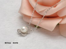 New design clam shell shape with fresh water pearl and cubic zirconia pendant necklace