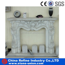 flower carved stone fireplace