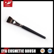 Matt black facial mask brush with synthetic hair