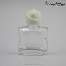 gel nail clear bottle with white flower cap and brush