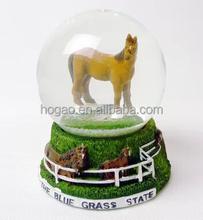 Kentucky the blue grass state horserace snow globe