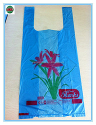 Custom printed plastic t-shirt bag on roll for shopping