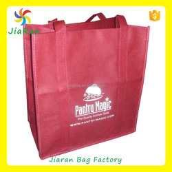 pantre magit non woven bag with dark red color material, handle from top to bottom bag