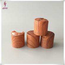 Special wood grain plastic shampoo disc top cap